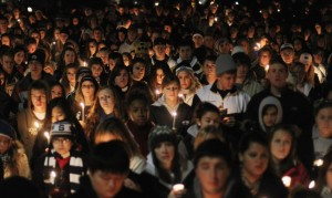 Penn State students and supporters hold a vigil for victims of child abuse in November 2011. Nearly 1 in 8 children will experience child maltreatment in their lifetime, a new study finds